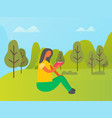 woman sitting on grass and reading book vector image vector image