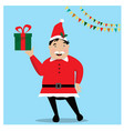 smiling man in santa red hat holding christmas vector image vector image