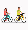 young boy and girl riding bicycles vector image