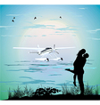 couple standing on the beach vector image vector image