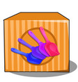 cardboard box with colored plastic shovels vector image vector image