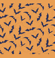 seamless pattern of bat on bright orange vector image vector image