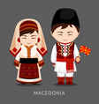 macedonians in national dress with a flag vector image vector image