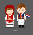 croats in national dress with a flag vector image vector image