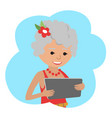 happy senior woman with tablet in hands vector image