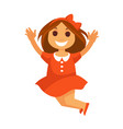 jumping little girl with smile in red dress vector image