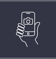 the hand hold the smartphone and photographed with vector image vector image