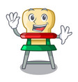 waving cartoon baby sitting in the highchair vector image vector image