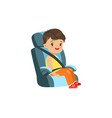 cute little boy sitting in blue car seat safety vector image vector image