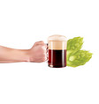 hand holding a glass of cold beer with full foam vector image vector image