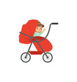 cute little kid sitting in a red baby pram safety vector image vector image