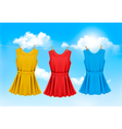 Set of colored dresses hanging on a clothesline on vector image vector image