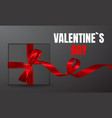 decorative black gift box with red bow isolated vector image vector image