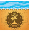 emblem of a palm over the sand and sea vector image vector image