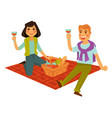 husband and wife on picnic with basket of food vector image