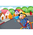 The fireman holding a hose rescuing a village on vector image vector image