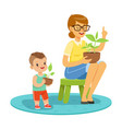 little boy learning about plants with teacher vector image vector image