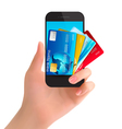 Credit cards in a phone Internet banking concept vector image