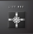 black gift box with white silver bow and ribbon vector image vector image