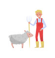 young man with pitchfork standing next to sheep vector image