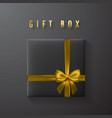 Black gift box with golden bow and ribbon top