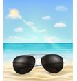 sunglasses on a bright sea sand beach vector image