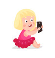 cute cartoon blonde girl sitting on a floor and vector image vector image