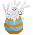easter bunnies in big colored egg cartoon vector image
