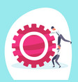 two businessmen pushing cogwheel hardworking vector image vector image