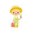 cute boy in overalls rubber boots and hat with vector image vector image