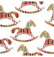Seamless pattern with rocking horses vector image vector image