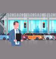 seller man in cars dealership center showroom vector image vector image