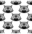 Seamless pattern of wise owl heads vector image vector image