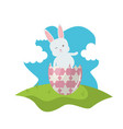 cute rabbit with broken easter egg painted in the vector image vector image