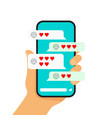 hand holding smartphone with heart emoji message vector image vector image