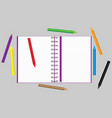 open notebook with scattered colored pencils vector image vector image