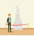 young man viewing antique statue at the museum vector image vector image