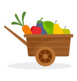 farm wheelbarrow fruits vegetables icon flat vector image