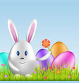 easter bunny and colorful eggs on spring medow vector image vector image