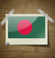 Flags Bangladesh at frame on wooden texture vector image vector image