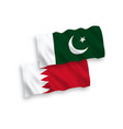 flags pakistan and bahrain on a white