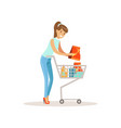 smiling woman with shopping cart shopping in vector image vector image