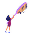 woman with big hairbrush vector image