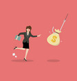 business woman try to pick money bag from hook vector image