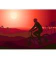 Mountain Biker Riding into the Sunset vector image
