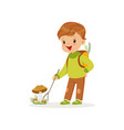cute little boy in warm clothing collecting vector image