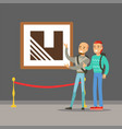 two young men standing in modern art gallery vector image vector image