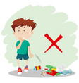 a boy throwing garbage on street vector image vector image