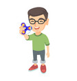 caucasian little boy playing with fidget spinner vector image vector image
