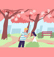 cute happy couple viewing cherry tree blossom vector image vector image